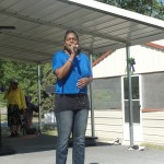Please Stand as Ms. Kima Whipple-Jackson leads the National Anthem.